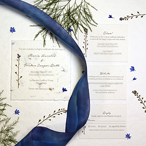 seed paper wedding invitations with ribbon