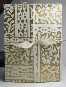 invitation shell with golden woodcut print and eco-twist wrap