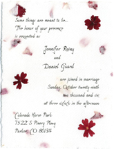 cotton paper invitation with pressed flower applique