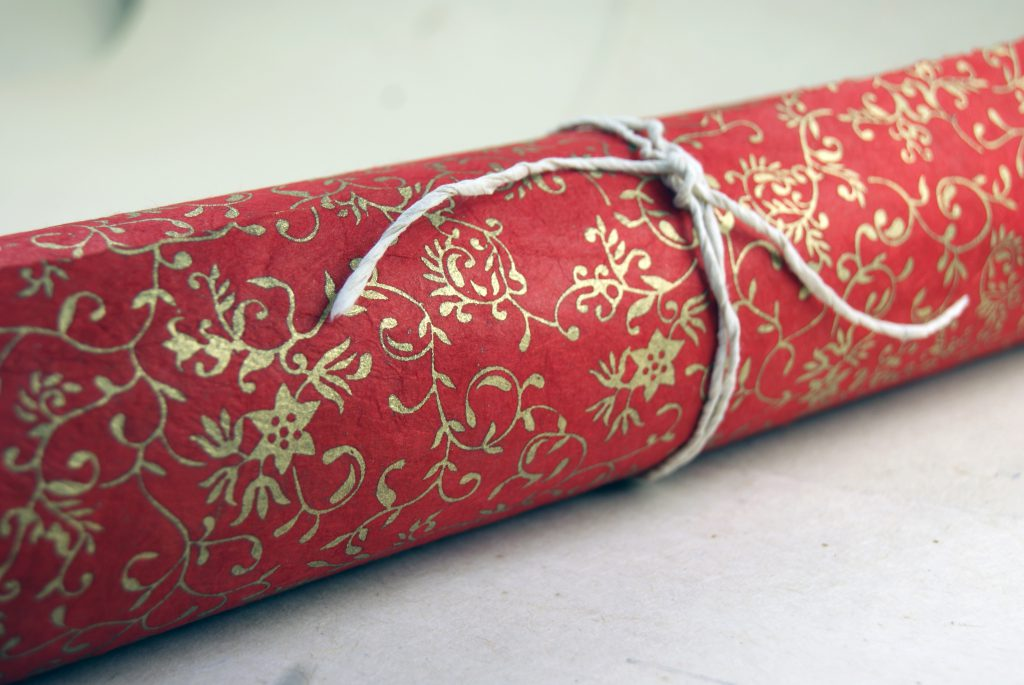 gold and red floral print paper