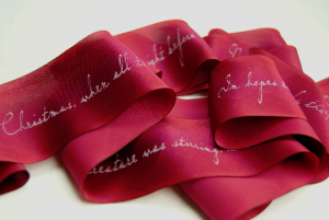Printed silk ribbon with white lettering