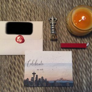image of candle, wax seal and a card