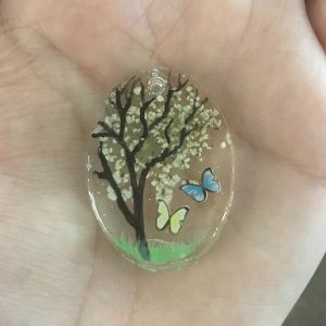 close up of botanical pendant